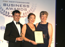 Jan and David collecting their 'East Herts Business of the Year' award from FSB Hertfordshire chair, Pam Charman.